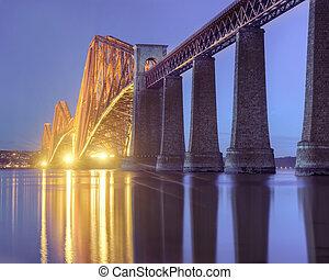 Floodlit Forth Bridge during the Blue Hour - A floodlit...