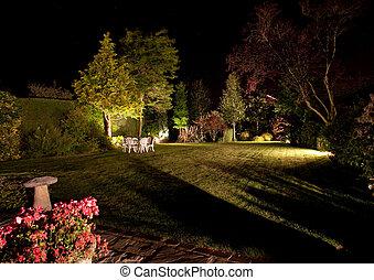 Floodlit garden - Well tended garden and flowers floodlit at...