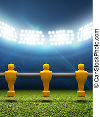 Floodlit Stadium With Foosball Players - A football stadium...
