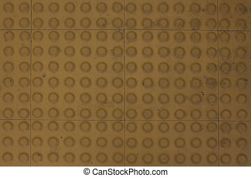 Floor beige tiles with little mosaic circles.