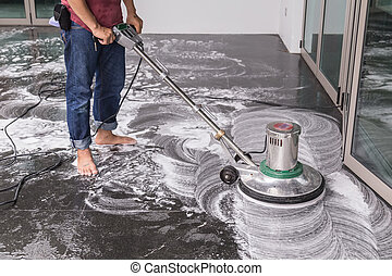 Floor cleaning with big machine - Thai people cleaning black...
