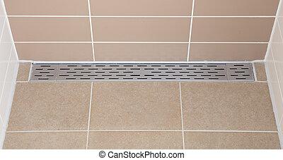 Floor drain in a modern shower