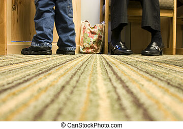 Floor Level Shot of Mom and Son at a Doctor\\\'s office