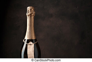 Floor of a champagne bottle on a brown concrete background.