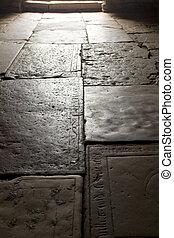 Floor of very old church in France made of tombstones
