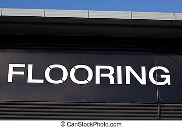 Flooring sign - Detail of wall with flooring shop sign.