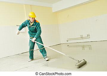 flooring works with self-levelling mortar - plasterer during...