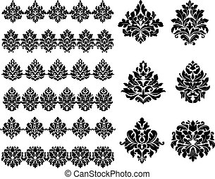Collection of black silhouetted floral and foliate design elements as arabesques