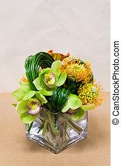 Floral arangement with Calla Lilies, cymbidium, protea
