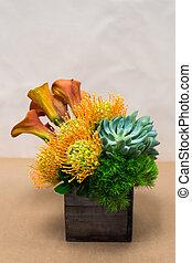 Floral arangement with Calla Lilies, Dianthus, succulent, protea