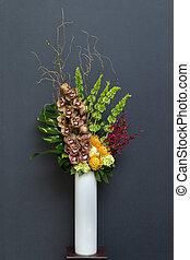 Floral arangement with Cymbidium, Hydrangea, Orchids, moluccella