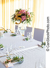 Floral arrangement for decoration wedding table for guests. Room