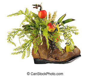 Floral arrangement made of artificial flowers and fruits.