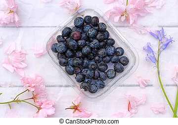 Floral background with blueberries
