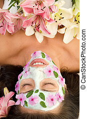 Floral Beauty - Woman with a botanical mask and flowers...