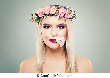Floral blossom portrait of beautiful woman with perfect makeup and flowers