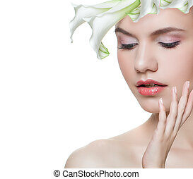 Floral blossom portrait of cute young woman face with white flower isolated