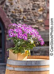 Floral decoration on old wooden barrel