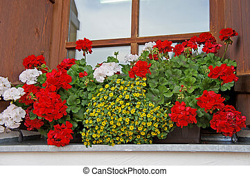 Floral decorations in Tyrol - Floral decoration at a window ...
