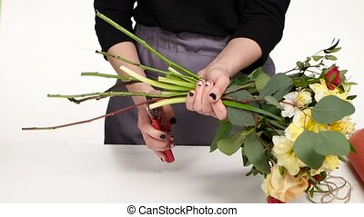 Floral design. Floral arts. White. Close up - Florist cuts...