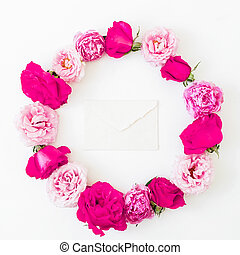 Floral frame made of pink roses flowers on white background. Flat lay, Top view. Valentines day