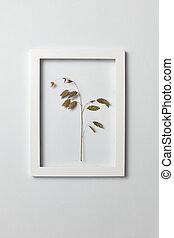 Floral frame with natural organic leaf on a light background.