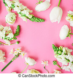 Floral frame with white flowers on pink background. Flat lay, top view.