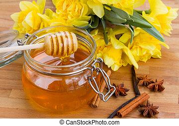 floral honey ??? - floral honey pot with spises on wooden...