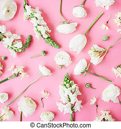Floral pastel pattern of white flowers on pink background. Flat lay, top view. Floral background.