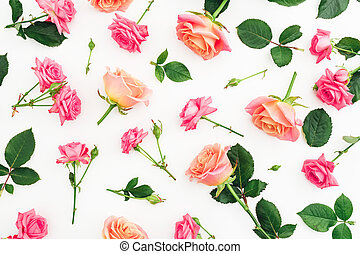 Floral pattern of roses flowers, petals and leaves isolated on white background. Flat lay, top view.