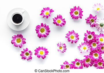 Floral pattern with cup of coffee on white background top view