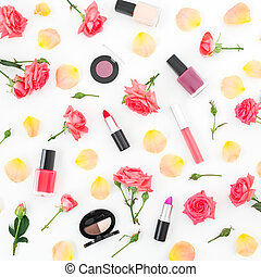 Floral pattern with orange roses flowers and feminine cosmetics on white background. Flat lay, top view.