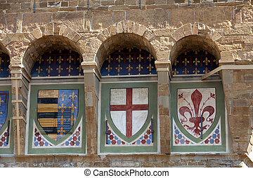 Florence - coats of arms on the wall Palazzo Vecchio