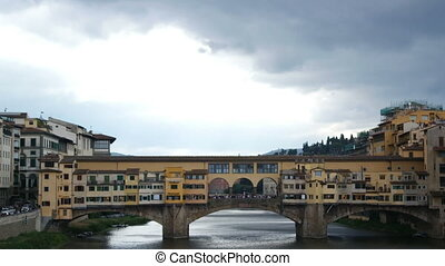 Florence Italy - SEPTEMBER 7, 2016. Arno River in the heart of the city. Ponte Vecchio (Old Bridge)