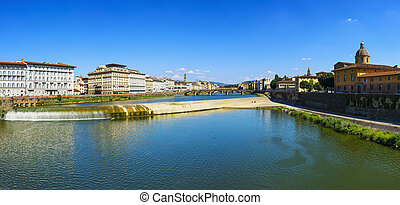 Florence or Firenze panoramic view of Arno river and Carraia medieval bridge. Italy