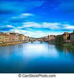 Florence or Firenze, Santa Trinita and Old Bridge landmark on Arno river, sunset landscape with reflection. Tuscany, Italy. Long exposure.