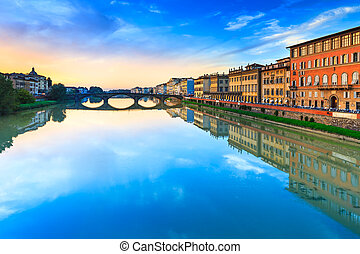 Florence, Ponte alla Carraia medieval Bridge landmark on Arno river, sunset landscape with reflection. It is the second oldest bridge, built in 1218, in the city. Tuscany, Italy.