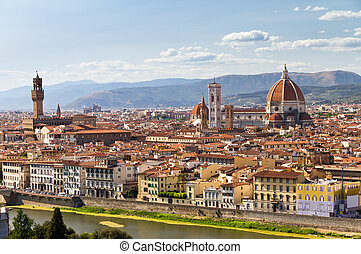 Beautiful view over the city of Florence, Italy, with the Cathedral, the Palazzo Vecchio and the river Arno