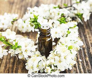 flores brancas, essência, garrafa