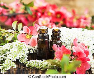 flores mola, essência, garrafas