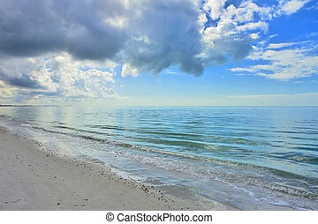 Florida - Beach at calm afternoon, moody clouds . high...