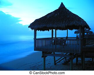 Florida beach hut - A sunrise comes to reveal a row of huts...