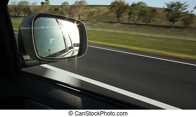 Florida highway. Sunny side mirror.