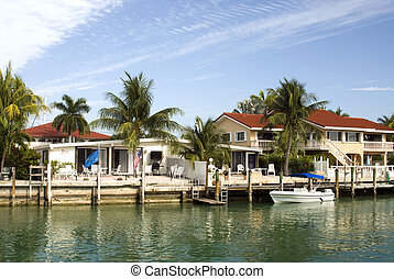 florida keys canal scene - canal channel with boats and...