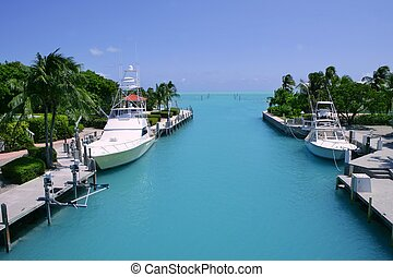 Florida Keys fishing boats in turquoise waterway - Florida...