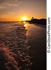 Florida Keys Sunset. Calm Ocean Waters near Sunset. Vertical...