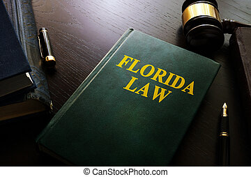 Florida law and gavel on a table.
