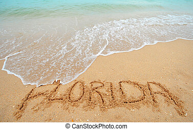 Florida written in sand - A warm tropical beach with blue...