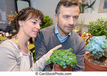 Florist advising customer