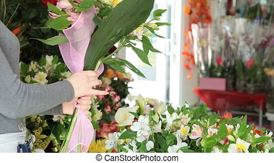 Florist Arranging Bunch Of Flowers